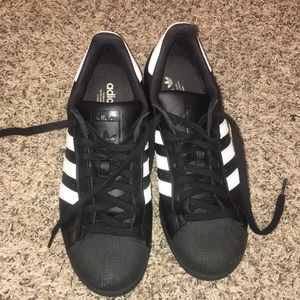 Black adidas superstar sneakers
